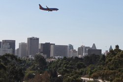 Airplane over San Diego skyline